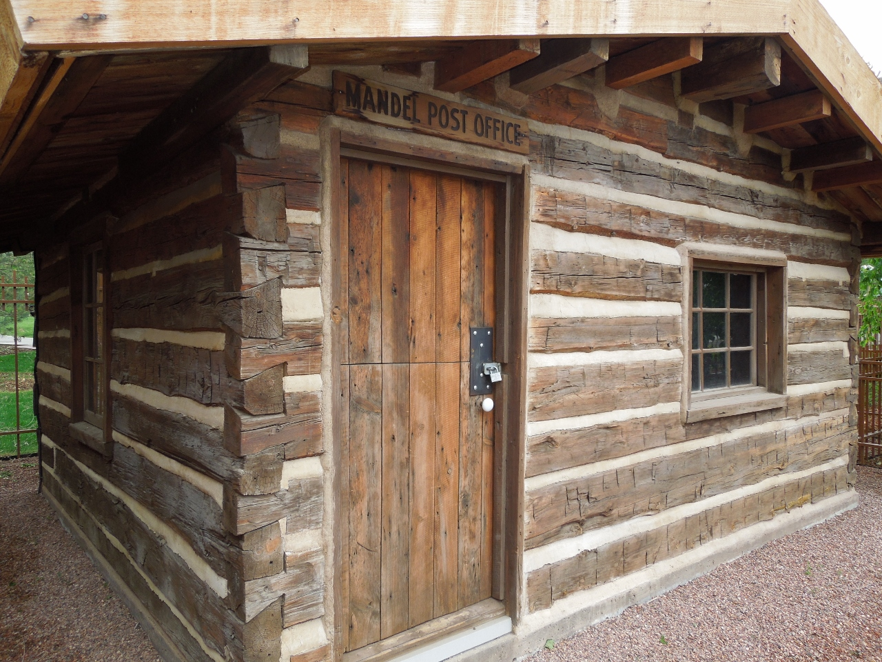 Log Cabin And Its Town. Full resolution  picture, nominally Width 1280 Height 960 pixels, picture with #90613B.