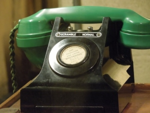 Telephones with a green receiver have a scramble button for classified conversations.