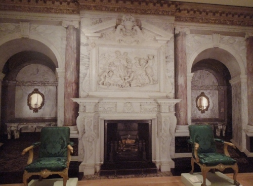 Furniture from the Marble Parlour in front of a large photo of the real parlour papering the wall.